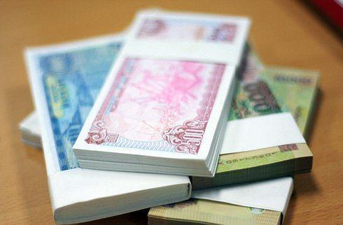 Tiền lẻ mới in mệnh giá từ 10.000 đồng trở xuống không được đưa vào lưu thông dịp Tết. Ảnh: Nhật Minh.