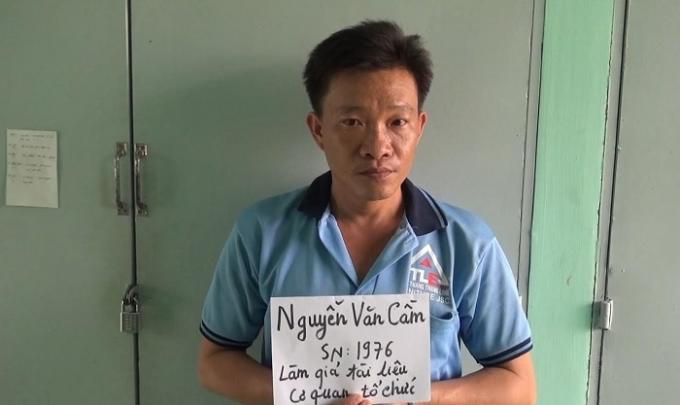 Đối tượng Nguyễn Văn Cầm tại cơ quan công an.