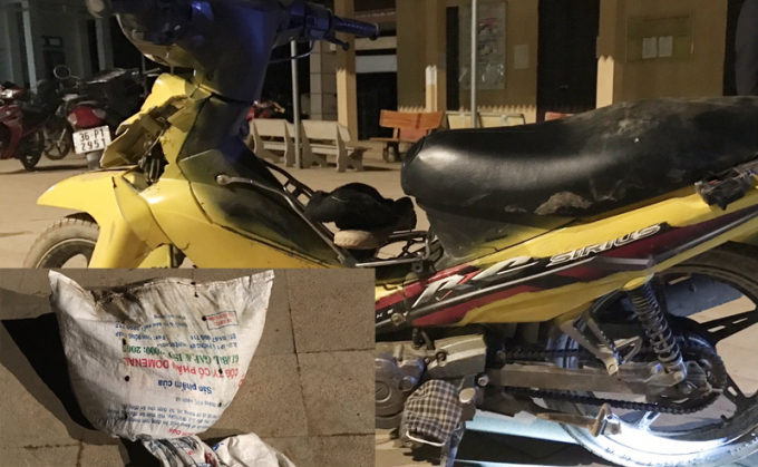 Chiếc xe máy cùng tang vật trộm chó bị bắt giữ. (Ảnh: CA Thanh Hóa)