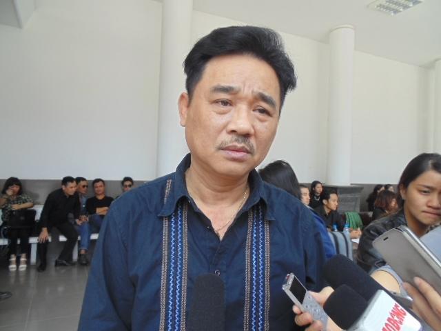 Nghệ sĩ Quốc Khánh xuất hiện trong buổi tang lễ với gương mặt bần thần.Ảnh: Nguyễn Hồng.Anh chia sẻ: