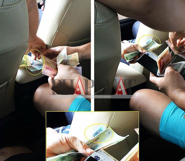 Tài xế taxi dù 51G-054.17 tráo tiền của khách Hàn Quốc. (Ảnh cắt từ clip) Ảnh: N.TÂN