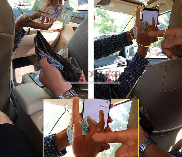 Tài xế taxi dù 51G-503.52 tráo tờ 500.000 đồng của khách thành tờ 20.000 đồng. (Ảnh cắt từ clip) Ảnh: N.TÂN