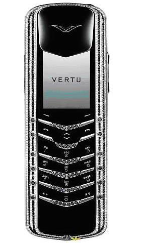 Điện thoạiVertu Signaturebằng vàng được trang trí bởi 644 viên kim cương trắng và 428 viên kim cương đen.