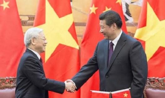 Chủ tịch Trung Quốc Tập Cận Bình (phải) đón tiếp Tổng Bí thư Đảng Cộng sản Việt Nam Nguyễn Phú Trọng tại Bắc Kinh ngày 7/4/2016. (Ảnh: Tân Hoa xã)
