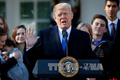 Tổng thống Donald Trump tại cuộc họp báo ở Washington D.C ngày 19/1. Ảnh: THX/TTXVN