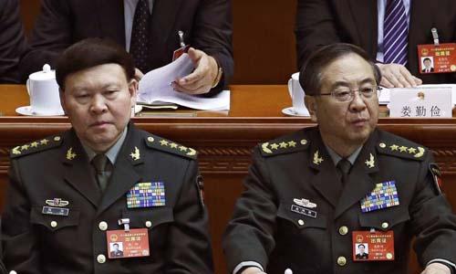 Ông Trương Dương (trái) và ông Phòng Phong Huy bị khai trừ khỏi đảng Cộng sản Trung Quốc. Ảnh:AP.