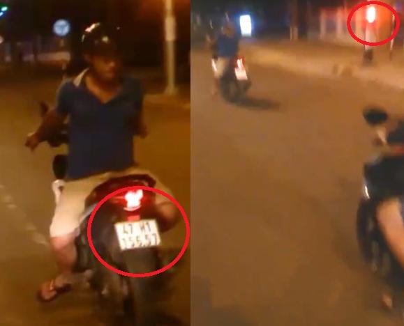 Nam thanh niênđiều khiển xe quay lưng về phía trước, vượtđènđỏ. (Ảnh: Cắt từ clip)