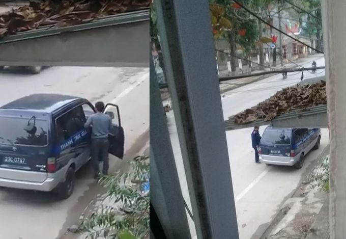 Hình ảnh chiếc xe thanh tra giao thông BKS 23C - 0747 dừng bên đường. Ảnh: Cắt từ clip.
