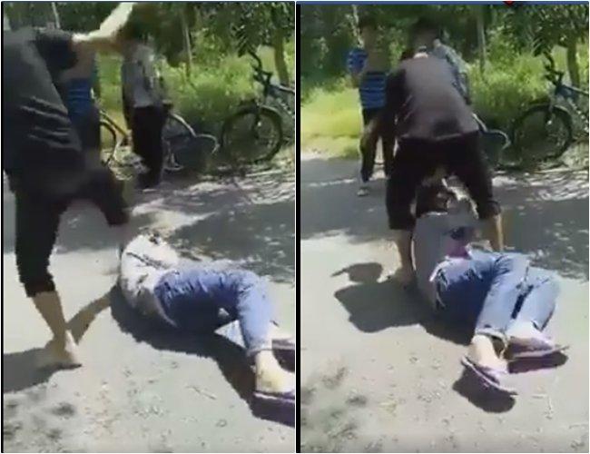 V.N.T.U bị nhóm bạn hành hung, bắt liếm chân cắt từ clip. Ảnh: Dân trí