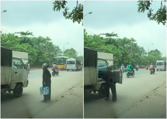 Cụ bà được tài xế xe tải cho đi nhờ quá giang - Ảnh cắt từ clip