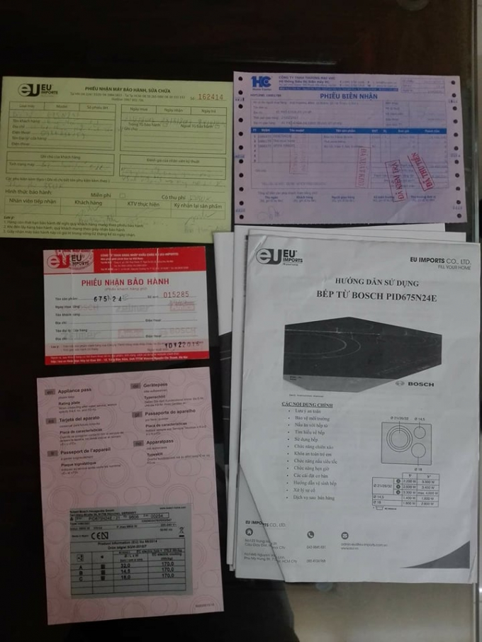 Các giấy tờ liên quan đến sản phẩm bếp từ bị hỏng của khách hàng Anh.