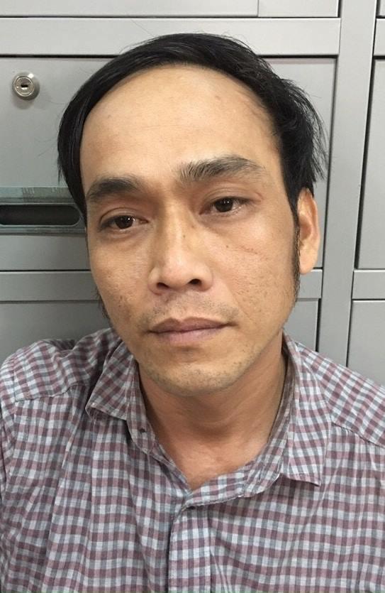 Đối tượng Nguyễn Tiến Thịnh tại cơ quan điều tra (ảnh công an cung cấp).