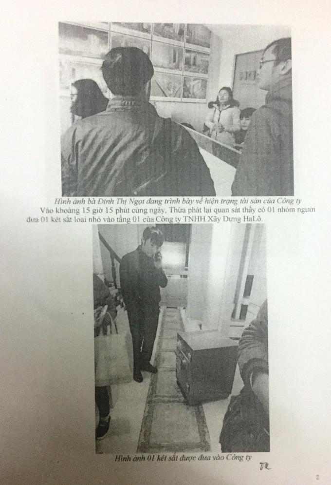 Vi bằng do Thừa phát lại lập có hình ảnh được cho là ông Huy và một số người mang trả két sắt cho công ty