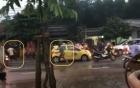Điều khiển xe taxi làm vung nước, tài xế bị 3 thanh niên đánh hội đồng