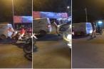 Cảnh sát giao thông còng lưng đẩy xe ô tô chết máy giữa đường