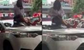 Bị CSGT dừng xe, nữ tài xế taxi trèo lên nóc xe ăn vạ