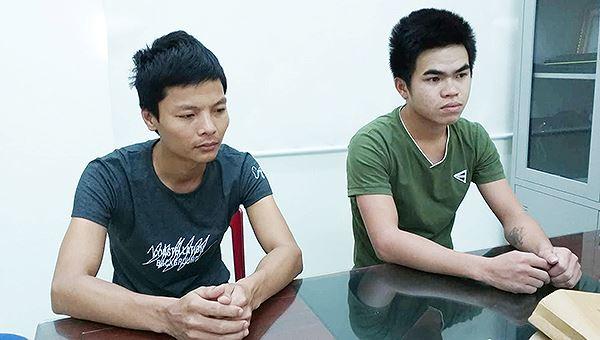 Lê Xuân Hải (trái) Nguyễn Cảnh Quang (phải) tại CQĐT.
