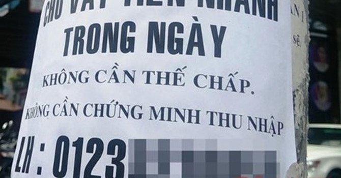 Quảng cáo cho vay nặng lãi nhan nhãn khắp nơi.