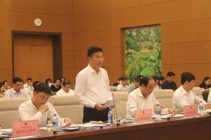Bộ trưởng Lê Thành Long giải trình trước Ủy ban Pháp luật Quốc hội