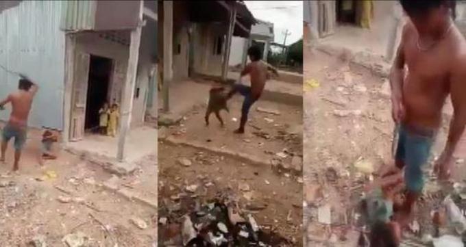Cảnh người cha ruột bạo hành đứa con gái 6 tuổi gây phẫn nộ.Ảnh cắt từ clip.