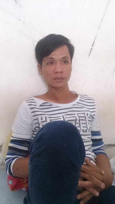 Bùi Quốc Thuận tại cơ quan công an.