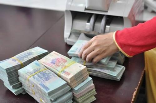 Giao dịch rút tiền mặt với Kho bạc Nhà nước cấp tỉnh từ 200 triệu đồng trở lên sẽ phải đăng ký trước mộtngày làm việc. Ảnh:Hoài Thu