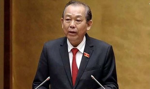 Phó Thủ tướng Thường trực Chính phủ Trương Hòa Bình trình bày báo cáo tại phiên họp.