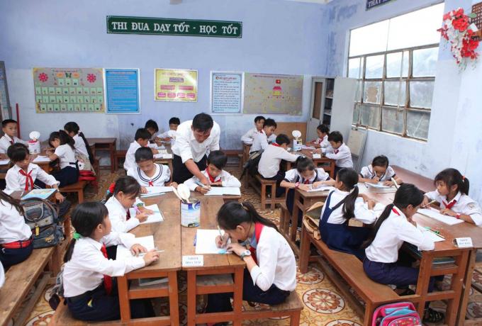 Với giáo dục phổ thông, nhiệm vụ năm 2019 là khẩn trương chuẩn bị điều kiện triển khai chương trình giáo dục phổ thông mới. (Nguồn: TTXVN)