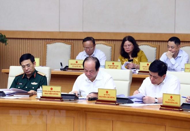 Các thành viên Chính phủ và đại biểu tham dự phiên họp. (Ảnh: Thống Nhất/TTXVN)