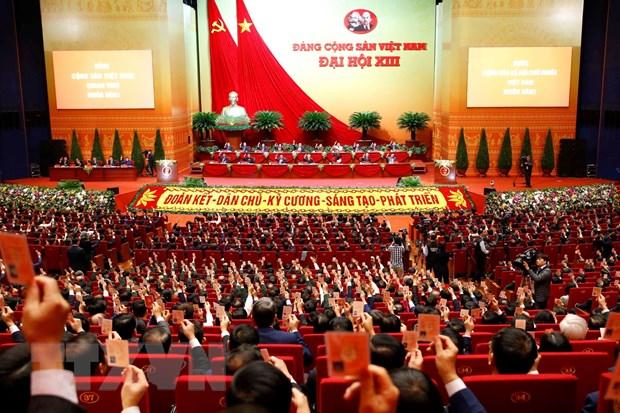Các đại biểu biểu quyết thông qua Chương trình làm việc của Đại hội. (Ảnh: TTXVN)