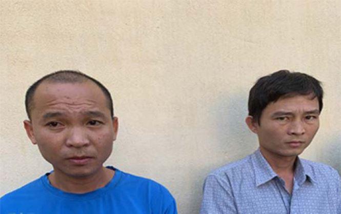 Hai cán bộ Hoàng Văn Sơn và Bùi Ngọc Dũng tại cơ quan điều tra.