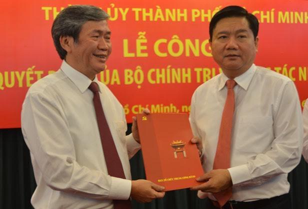 Thường trực Ban Bí thư Đinh Thế Huynh và tân Bí thư Thành ủy TP.HCM Đinh La Thăng.