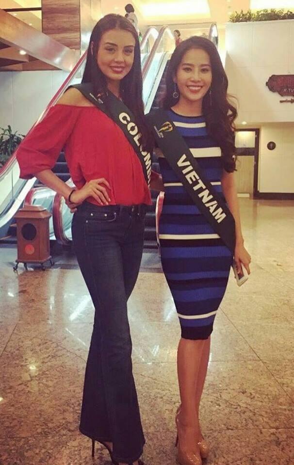 Người đẹp Nam Em rạng rỡ bên đại diện nhan sắcColombia.