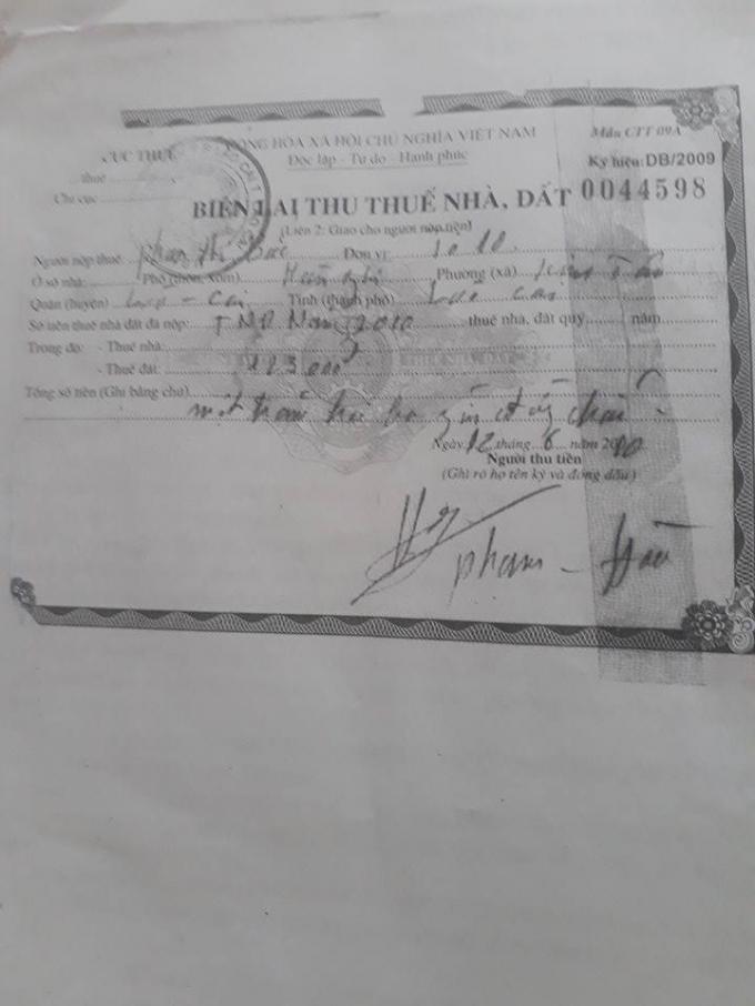 Biên lai thu thuế nhà đất của hộ bà Phan Thị Bắc.