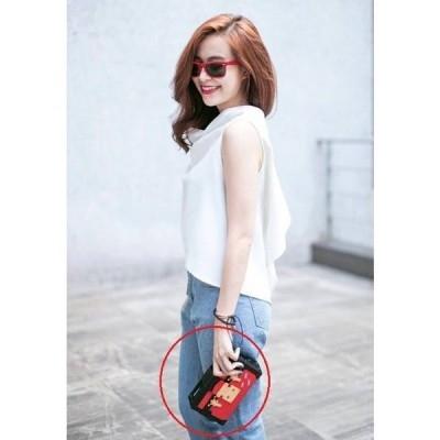 Chiếc túi mà Hoàng Thùy Linh luôn mang theo bên mình giống với chiếc túi của cô gái giấu mặt đặt trên bàn. Ảnh: internet.