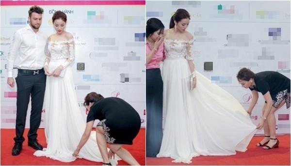 Hoa hậu Kỳ Duyên để mẹ nâng váy cho mình.