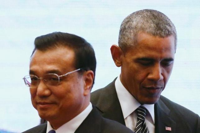Tổng thống Mỹ Barack Obama và Thủ tướng Trung Quốc Lý Khắc Cường.(Ảnh: Reuters)