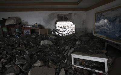 Hiện trường xảy ra vụ lở núi kinh hoàng tại Trung Quốc.  (Ảnh: Reuters)