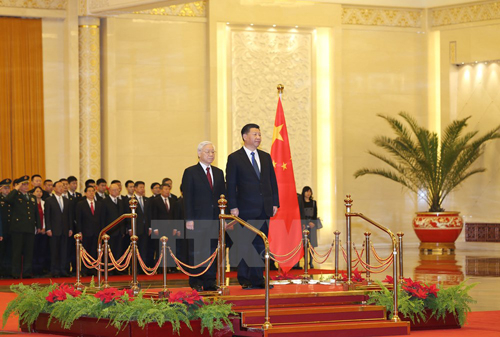 Tổng Bí thư Nguyễn Phú Trọng và Chủ tịch Trung Quốc Tập Cận Bình tại lễ đón. Ảnh:TTXVN