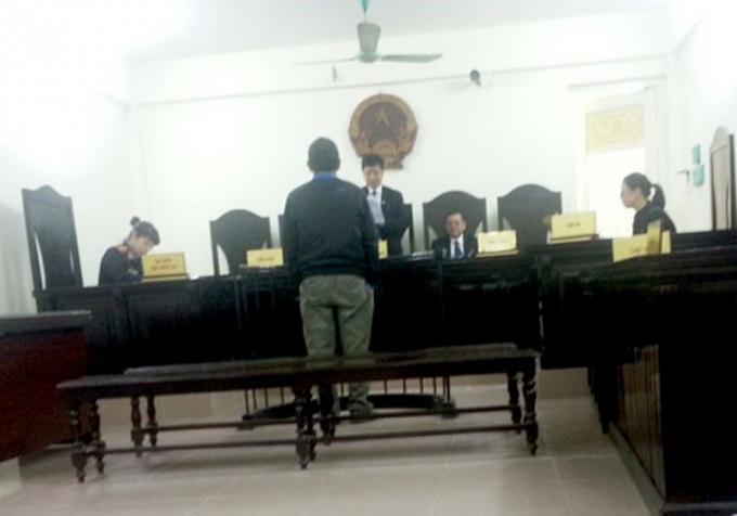 Ông Phạm Ngọc Quế trước vành móng ngựa trong phiên tòa phúc thẩm.