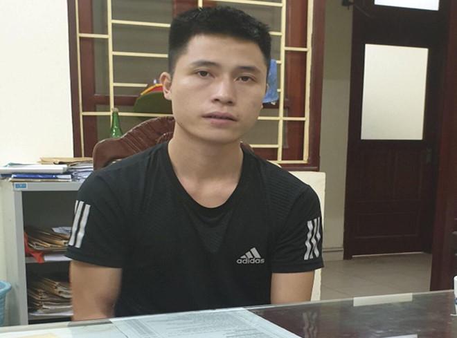 Đối tượng Nguyễn Duy Cường tại cơ quan Công an. Ảnh cơ quan Công an cung cấp.
