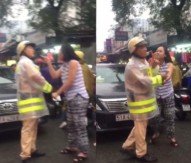 Người phụ nữ luôn có hành động lôi kéo, chỉ thẳng vào mặt người chiến sĩ CSGT. Ảnh cắt từ clip.