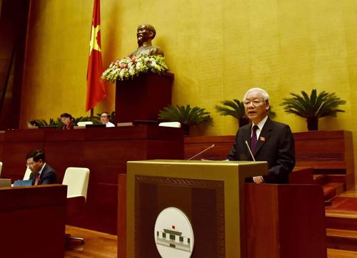Tổng Bí thư, Chủ tịch nước Nguyễn Phú Trọng trình bày Tờ trình về việc đề nghị Quốc hội phê chuẩn Hiệp định CPTPP. Ảnh: VGP/Nhật Bắc