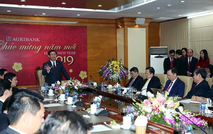 Phó Thủ tướng Vương Đình Huệ phát biểu tại cuộc làm việc với lãnh đạo, cán bộ, nhân viên Ngân hàng Agribank ( Ảnh: VGP/Thành Chung)