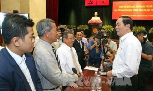 Chủ tịch nước Trần Đại Quang cùng Đoàn đại biểu Quốc hội Thành phố gặp gỡ các doanh nghiệp, doanh nhân Thành phố Hồ Chí Minh. (Ảnh: Nhan Sáng-TTXVN)