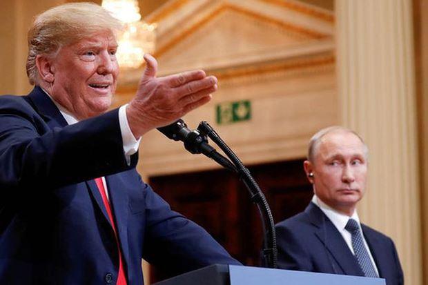 Tổng thống Mỹ Donald Trump (trái) và Tổng thống Nga Vladimir Putin. Ảnh Reuters