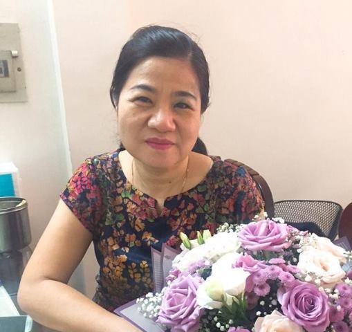 Bà Phạm Thu Dung, nhân viên Trung tâm Y tế Dự phòng Hà Nội.