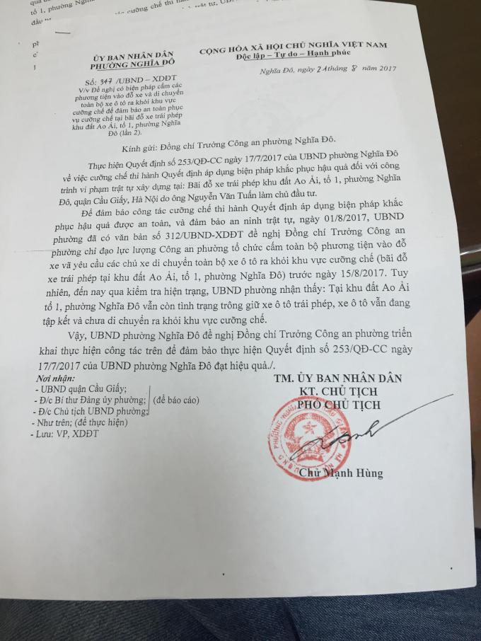 Văn bản gửi Công an phường Nghĩa Đô về việc giải phóng bãi xe nhưng đến nay bãi xe vẫn hoạt động.