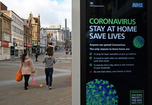 Nếu xuất hiện làn sóng nhiễm Covid-19 thứ 2, GDP của Anh có thể trượt sâu đến 14% trong năm 2020. Ảnh: AFP