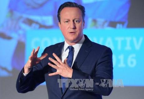 Thủ tướng Anh David Cameron phát biểu tại thủ đô London ngày 9/4. Ảnh: AFP/TTXVN